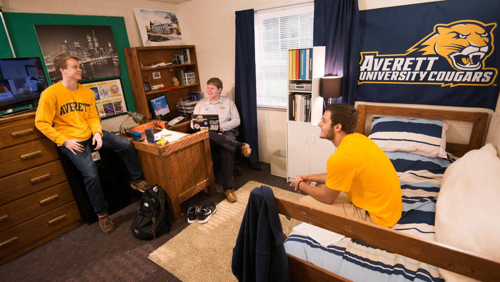 male students in averett dorm room